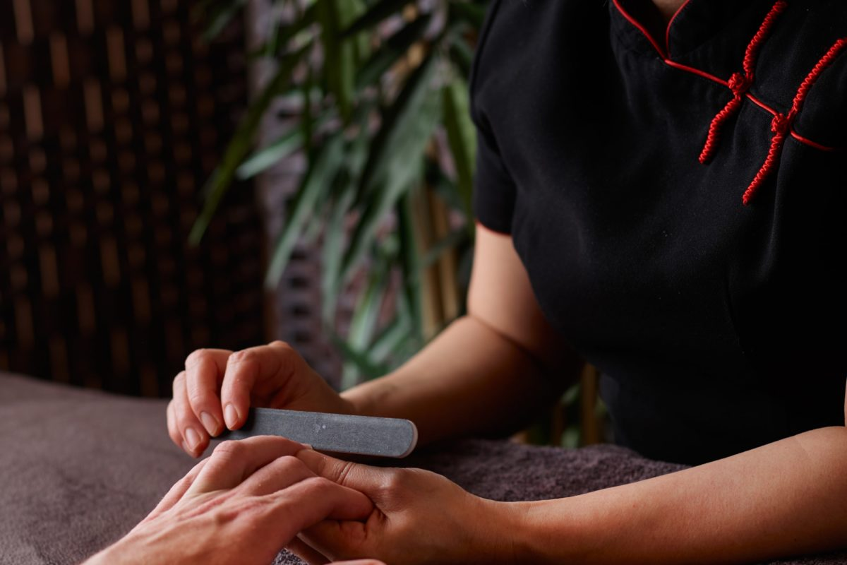 Tension in the hands and arms is eased with a soothing massage during the Hand Grooming spa treatment for men.