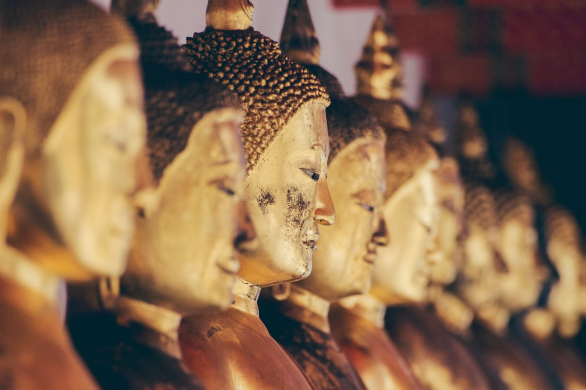 Golden Thai statues in a row