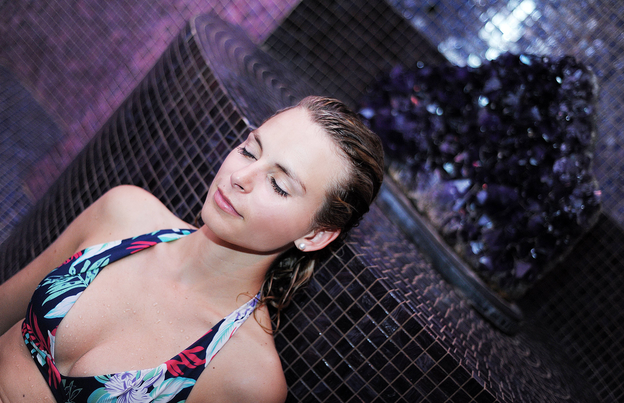 Woman relaxing in the crystal steam room