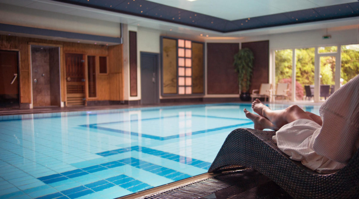 A woman relaxing by the pool at SenSpa